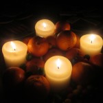 Candle_lighting_a_plate_of_oranges_and_smarties_1